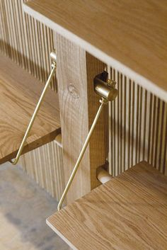 lonewa custom shelving system brass and wood shelving detail.