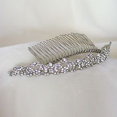 Exquisite wedding tiaras in a variety of bridal tiara styles. Crystal, crowns and pearl back pieces, modern, traditional & vintage tiara styles. Make your special day unforgettable.