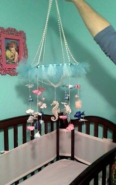 Mermaid Tutu Chandelier mobile for girl's nursery -made with toole, Christmas ornaments, lei flowers, metal ring and pearl strands all from Hobby Lobby. Way cheap to make!