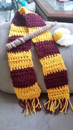 Crochet Harry Potter Baby photo probably. Wand, scarf,  and snitch for $12.