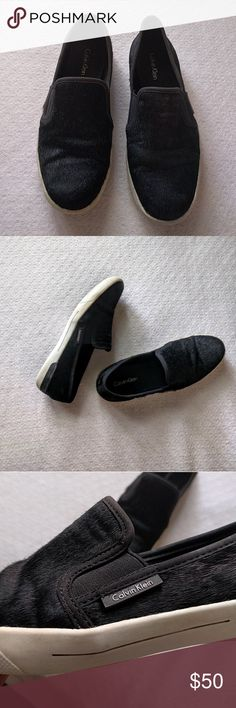 Women Black Calvin Klein Slip On Great condition women Calvin Klein fashion slip on with feather texture. This shoes hoes well with jeans shorts Shoes Sneakers