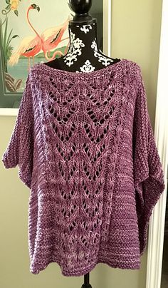 This is a very easy adult size garter stitch poncho with a lace panel in front. It is knit with a single strand of bulky or worsted weight held doubled on size 13 needles. Model is knit with Noro Shirakaba, doubled. Very easy to adjust size.