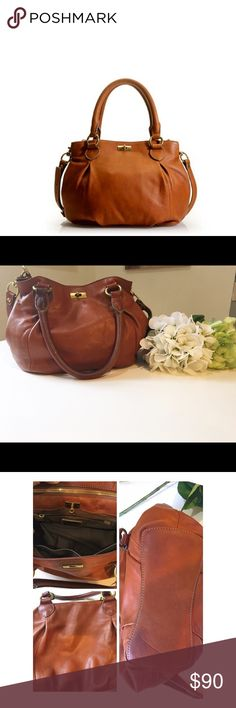 J crew brompton mini hobo bag Great leather mini hobo bag in henna. Don't let the size fool you, this will still fit a LOT. Very good condition, gently used. A couple of small marks on the interior leather, one small mark on the front. 4th photo. J. Crew Bags Hobos
