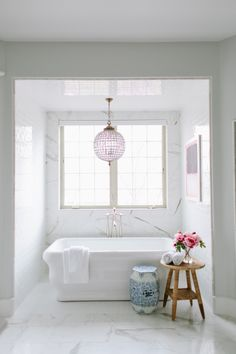 Side tables ideas for a modern bathroom interior #bathroominteriordesign #bestbathrooms #bathroomdesign side table design, beautiful bathrooms, modern bathroom . See more inspirations at www.coffeeandsidetables.com