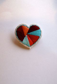 Embroidered heart brooch with geometric shapes by AnAstridEndeavor, $25.00
