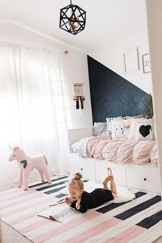 girls bedroom with black and pink accents, cream walls, benjamin moore black ink, pink and black striped rug, black accent wall, pale pink, soft pink