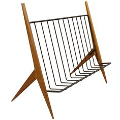 Spectacular designed mahogany and iron magazine rack with svelte sculpted legs. These were distributed by Raymor in the 1950s.