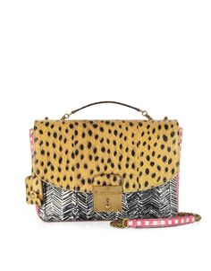 The Ayers Mini Polly by Marc Jacobs is a classically styled flap bag crafted in a patchwork pattern of ayers snakeskin printed with custom Marc Jacobs designs.