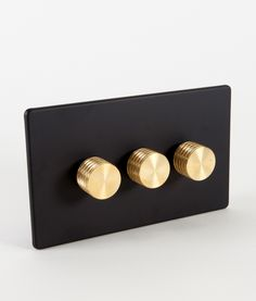 Our designer dimmer switch treble black & gold has a matt black back plate with three gold knurled knobs. 2 way switch with concealed fittings.