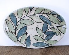 Lapella Pottery Oval Serving Platter - Scrolling Leaves in Bone white, Green, and Teal via Etsy