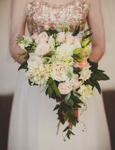 cascading blush pink bouquet of dahlias and juliet roses