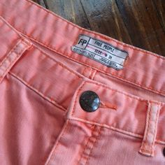 Free People Peach Skinny Jeans with Zipper Detail *The first picture accurately represents the color!* 78% cotton/20% polyester/2% spandex. Machine wash. No stains or rips! Great condition! Be sure to check out the rest of my closet! I offer a discount on items bundled from my closet! Free People Jeans Skinny