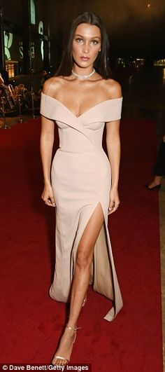 Legs AHOY! Bella, 19, went for a stunning nude gown which featured a thigh-high slit and flesh-flashing sweetheart neckline