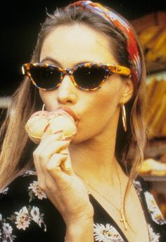 Emmanuelle Beart. Lady really knew how to work a cone back in the day. Never has ice-cream-as-accessory looked so chic. #casual  http://asos.to/1oVrBi0