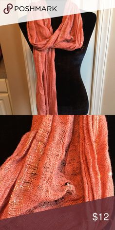 Odd peach, orange color shimmer scarf Excellent condition. 10 day sale and will be donated if not sold by 11 /20. Sold as is and price is firm. Nonsmoking home Accessories Scarves & Wraps