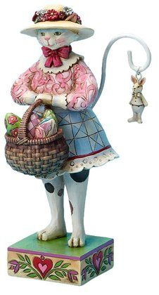 Jim Shore cat figurine holding a basket of Easter eggs. She is in my collection