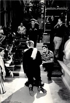 Fellini directing Marcello Mastroianni on set of 8 1/2, 1962