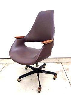 Mid-century teak trimmed office chair.