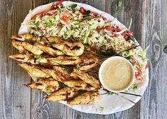 It's nearing the fourth of July, and this grilled chicken satay platter with creamy almond sauce is totally drool worthy if you're hosting.