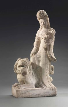 A CARVED MARBLE FIGURE OF A FEMALE IMMORTAL AND A BUDDHIST LION - 20th Century.