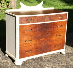 The detail in the grain of this wood is so beautiful! To bring out all of its natural beauty I belt sanded the drawers and the top and then stained it with Special Walnut color stain. The off white frame really helps it stand out. With the wood detail on the top and then antique hardware, it has the perfect amount of art deco charm.