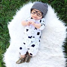 07.13.15 || My baby has more swagger than me.  || Fifteen weeks  Slouchy Beanie : @littlesunshinebaby hisster Baby Glasses : @mustachifier Monochrome Romper : @miniandmaximus Baby moccs : @sweetnswag