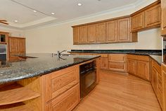 Granite countertops & warm cabinets staining