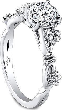 floral band with less clunky flowers. pair with a princess cut diamond
