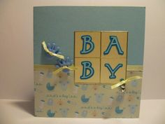 Card for new baby boy with shaped buttons & charm details