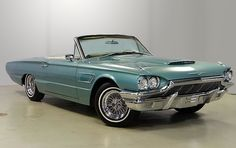 1965 Thunderbird Convertible, white interior, Kelsey Hayes spoke wheels.