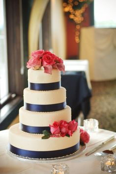Pink roses, navy blue ribbon, 4 tiered wedding cake at casa larga Navy Blue Wedding Cakes, Wedding Cake Fresh Flowers, Wedding Colors, Wedding Blue, Nautical Wedding, Trendy Wedding, Our Wedding, Dream Wedding, Cake Wedding