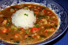 Crawfish Etouffée - Crawfish, simmered in a very simple butter roux, seasoned with a basic trinity, garlic, stock and Cajun seasoning, and finished with a little fresh parsley and green onion. Serve over hot rice with fresh French bread for dipping.