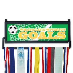 I love this idea for hanging and displaying the kids' soccer medals