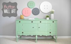 Button Wall Art.  Adorable idea for craft room or nursery!