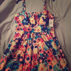 Floral Sundress Short, multicolored, zippered, spaghetti strapped sundress. Never worn-brand new with tags. Runs small B. SMART Dresses