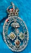 From Her Majesty's Jewel Vault: The Guards' Badge. This regimental brooch combines the symbols of the Grenadier Guards, the Coldstream Guards, the Welsh Guards, the Irish Guards, and the Scots Guards. The Queen wears it every year for the Trooping the Colour ceremony.