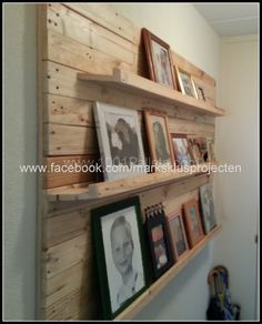 Photo wall made of recycled pallet wood | 1001 Pallets