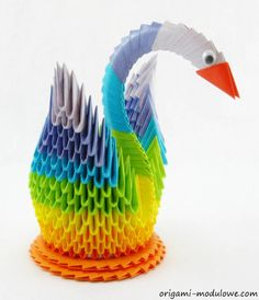 Polish artist Piotr Sokołowski creates colorful animals from intricately folded paper. I could call this work origami, but it is not like any origami I have seen. Origami is traditionally subtle and seems to use the least amount of folds possible to articulate a form and describe a shape. Sokołowski's work may have more in common with basket weaving with repeating patterns and textures.