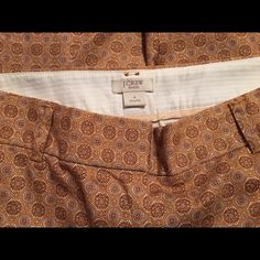 """J. Crew Stretch Capris Size 4 These are never worn size 4 J. Crew Capris. They have a dual tab closure and zipper. They still have the """"remove before washing"""" tag inside. The pants are a peach/tan paisley print. If you'd like additional pictures please let me know. I'm new to Poshmark so please share and let's follow each other's closets! J. Crew Pants Capris"""