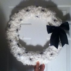 """Coffee filter """"Halloween"""" wreath.  * the bow & spiders are not permanent so I have endless options* and let me tell you the coffee filter wreath is GORgEOUS on it's own!!"""