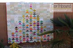 Northbound Flying Geese Scrap Quilt using brights and low-volumes - Tutorial | Piece N Quilt