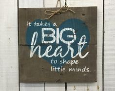I AM NOT TAKING ANYMORE CHRISTMAS ORDERS. Thank you for you continued support and understanding. We hope you have a wonderful Holiday Season! This cute little wood sign is made from reclaimed pallets. It would make a beautiful gift for any teacher, daycare provider, coach, nanny or anyone who works with your children. This sign is approx. 10x11 and the heart can be in any color you would like. You could also add names or places to this sign. All of my creations are made of reclaimed…