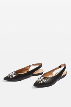 These slick black flat slingback shoes are a statement style. Featuring a stretchy strap and elegant toe point, the gorgeous gem embellishments add a touch of sparkle.
