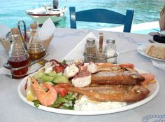 Greek Summer: red mullet, octopus, tzatziki, simple fresh salad with oregano... food from God