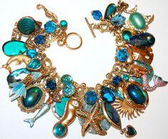 OOAK vintage SEA SIRENS mermaid CHARM bracelet GOLD tone AQUAMARINE kirks folly