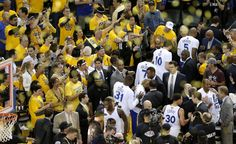 Fans cheer on the Warriors as they leave the court as the Golden State Warriors beat the Cleveland Cavaliers in game 5, of the NBA finals 104-91 at Oracle Arena in Oakland, , Calif., as seen on Sun. June 14, 2015. Photo: Michael Macor, The Chronicle