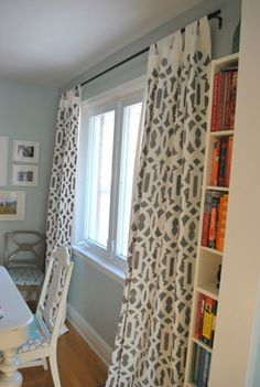 DIY gray stenciled curtains in a beautiful trellis pattern from The Sweet Digs blog