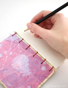 marbled endpapers on a handmade journal that lays completely flat when you open it for easy writing by Ruth Bleakley