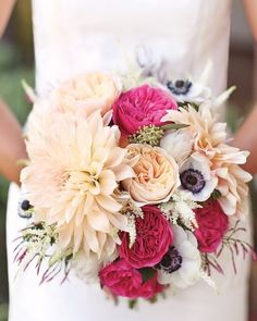 Honey and Poppies mixed this bridal bouquet with garden roses, dahlias, anemones, and astilbe, and included a locket holding photos of Amanda's mother and grandmother.