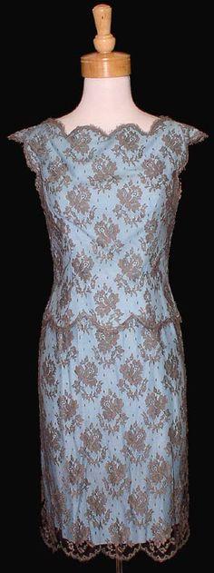 Classic vintage cocktail dress by Luis Estevez has a light turquoise under-dress, grey lace and scalloped hems.
